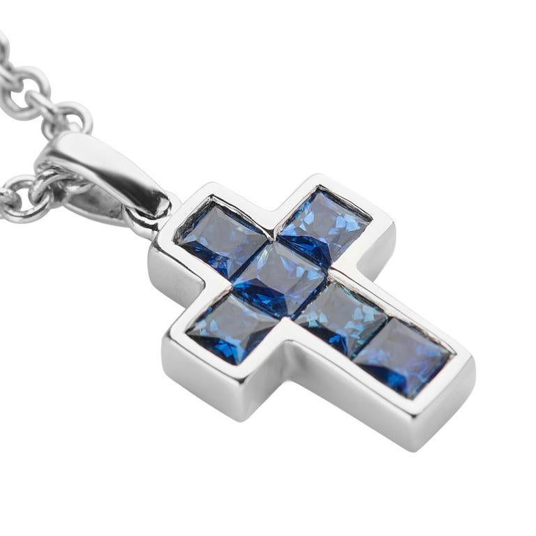 DEAKIN & FRANCIS, Piccadilly Arcade, London  This simple cross pendant is delicate and dainty. It is made up from 6 individual small sparkling blue sapphire gemstones encased in a 18ct white gold setting. This necklace makes a beautiful gift to give