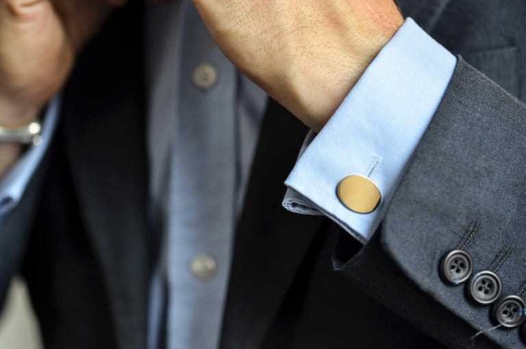 DEAKIN & FRANCIS, Piccadilly Arcade, London  These stunning, plain oval cufflinks have been made from the finest 18ct gold.  With chain fitting, they are a timeless addition to any wardrobe.  For a sophisticated look, why not choose to personalise