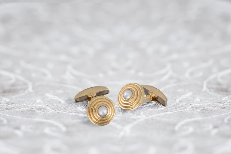 DEAKIN & FRANCIS, Piccadilly Arcade, London  These stunning 18kt gold and fresh water pearl cufflinks are perfect for all occasions. A truly classic pair of cufflinks that add a touch of elegance to any outfit!