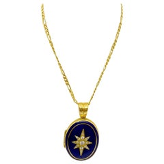 Deakin & Francis 18Kt Yellow Gold & Blue Enamel Oval Locket with Diamond Center