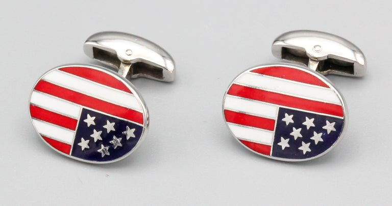 Handsome enamel and 18K white gold cufflinks by Deakin & Francis. They feature an American flag enamel theme.  Hallmarks: D&F, 750, English standard marks