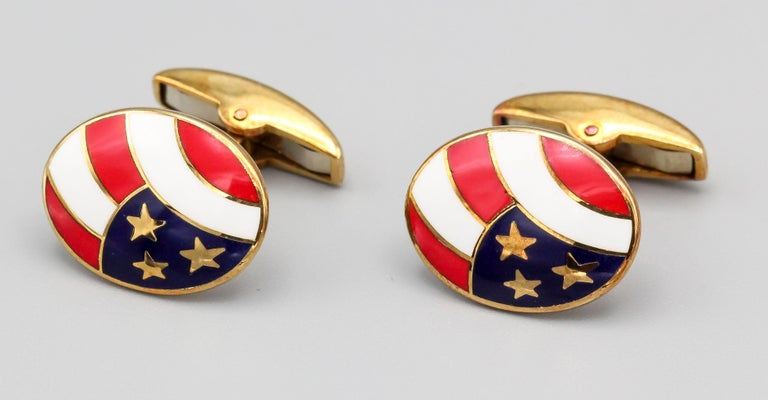 Handsome enamel and 18K yellow gold cufflinks by Deakin & Francis. They feature a stars and stripes enamel theme.  Hallmarks: D&F, 750, English standard marks