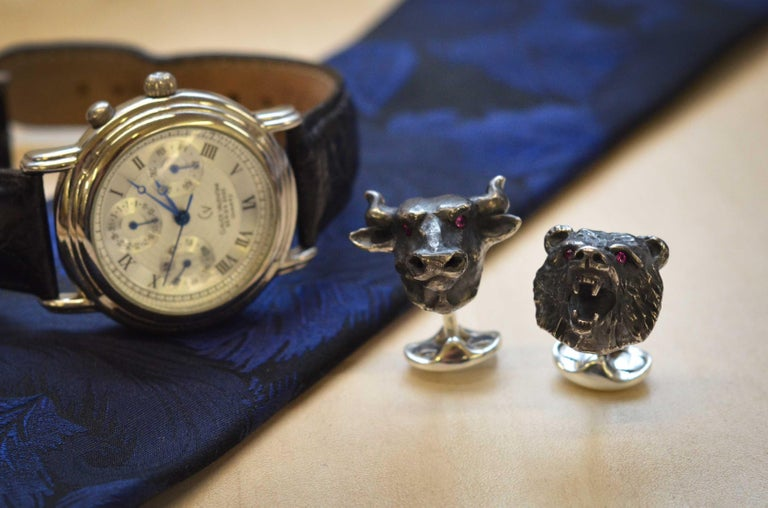 DEAKIN & FRANCIS, PICCADILLY ARCADE, LONDON.  These symbolic beasts of finance worn on the cuff will show that you really mean business. The bull symbolises the rise in the stock market whereas the bear signifies a slow decline. The ruby eyes