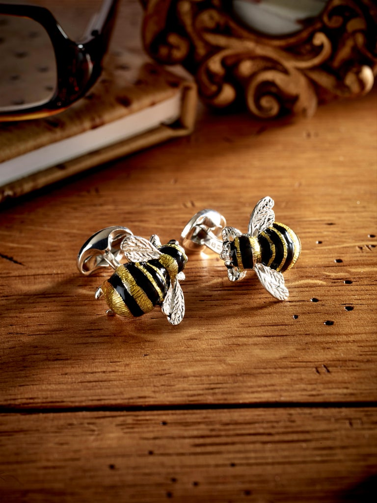 DEAKIN & FRANCIS, Piccadilly Arcade, London.  A familiar feature of the English countryside garden, the bumble bee's bright colours were the inspiration behind this fantastic set of cufflinks. The vibrant black and yellow enamel detail combined with