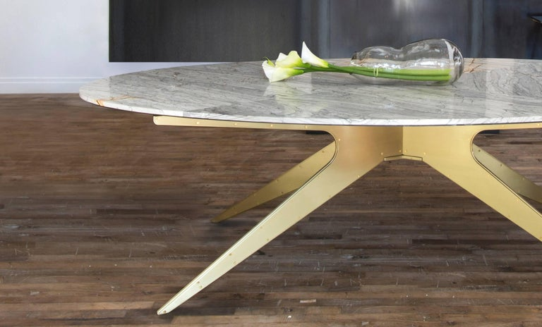 Inspired by silhouettes of Mid-Century Modern design, the Dean dining table feature various marble-top options supported by its bold and sculptural base below.  Custom sizes are not available.  Standard metal finishes are Satin Brass, Copper,