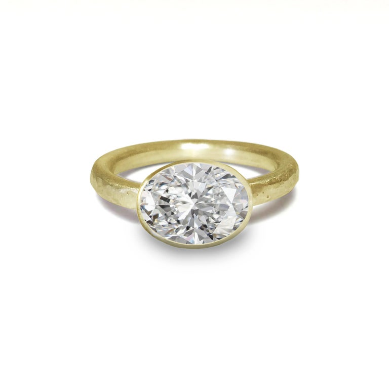 18 Karat Yellow Gold Ring by Deborah Murdoch is from the Abundance Collection featuring an oval 2.51ct Diamond Stone. The ring band is slightly planished giving that textural feel and has a silky satin finish.   Metal: 18 Karat Yellow Gold / This