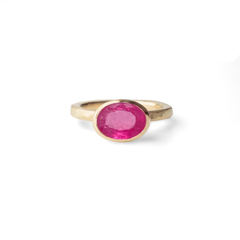 18 Karat Yellow Gold Ring by Deborah Murdoch is from the Abundance Collection featuring an oval 2.59ct Pink Tourmaline Stone. The ring band is slightly planished giving that textural feel and has a silky satin finish.   Metal: 18 Karat Yellow