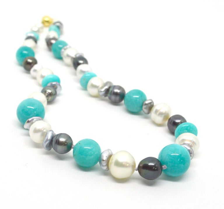Adorn your neck in luxury with the soft tones of Peruvian Amazonite with creams whites and greys Pearls. A mix of baroque Australian South Sea and Tahitian Pearls ranging from 9mm to 13.7mm. Necklace 50cm in length. Hand knotted on soft grey