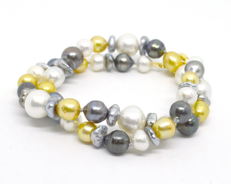 Adorn your neck in luxury with the soft tones of creams whites gold and greys. A mix of baroque Australian South Sea and Tahitian Pearls ranging from 10mm to 14mm. Necklace 51cm in length. Hand knotted on soft grey thread.  All Pearls are natural