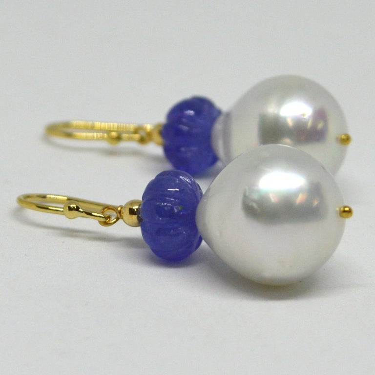 Natural Carved Tanzanite 9.3x5.6mm with 15x14mm high sheen South Sea Pearls set on 9ct yellow Gold Sheppard,  14k Gold head pin and 3mm round bead.  Total Earring length 40mm.