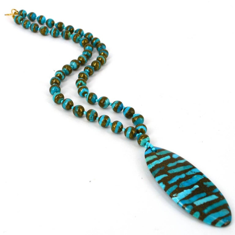 Vibrant Turquoise slices set into compressed Copper granules this necklace and earrings set makes a bold statement.  Necklace comes with a matching pair of earrings made with 14k Gold Filled findings, finished length of earrings is 25mm  Necklace