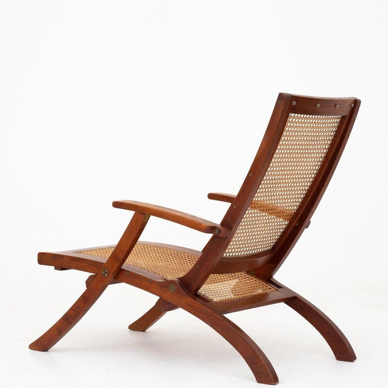 Deck chair in teak and French cane with brass hinges. Design 1933. Maker Rud. Rasmussen.