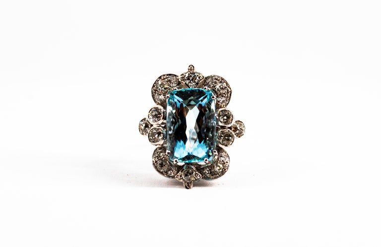 This Ring is made of 18K White Gold. This Ring has 2.90 Carats of White Old European Cut Diamonds. This Ring has a 12.60 Carats Aquamarine. Size ITA: 17 USA: 8 We're a workshop so every piece is handmade, customizable and resizable.