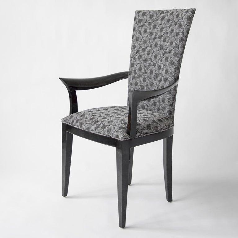 The Deco chair is an exquisite example of designer seating, featuring an elegant and sophisticated structure covered with gloss anthracite gray parchment and a padded seat and back upholstered in vintage fabric. Complete with armrests, it will