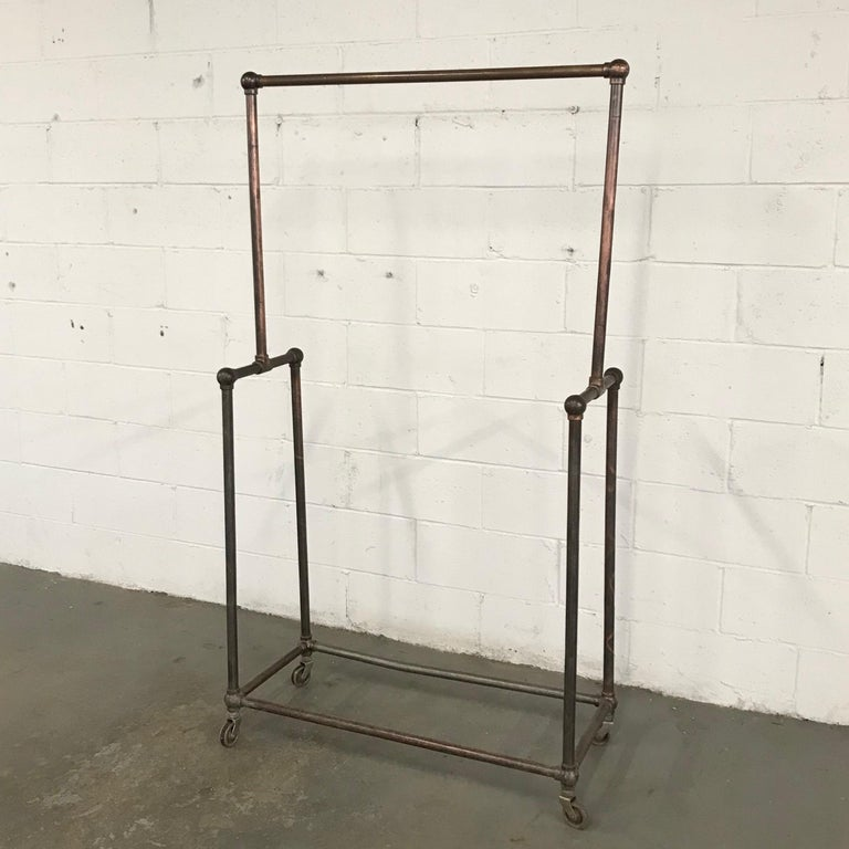 Industrial Deco Era Tubular Iron Rolling Garment Rack For Sale