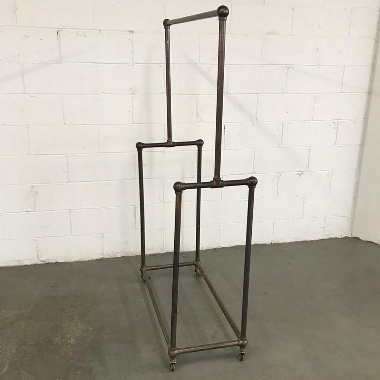 American Deco Era Tubular Iron Rolling Garment Rack For Sale