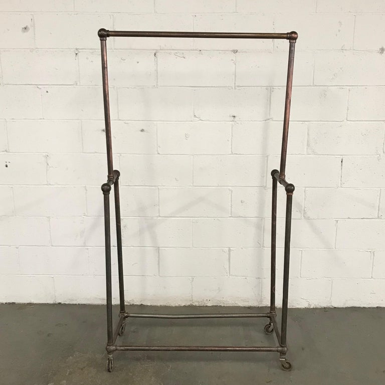 Deco Era Tubular Iron Rolling Garment Rack In Good Condition For Sale In Brooklyn, NY