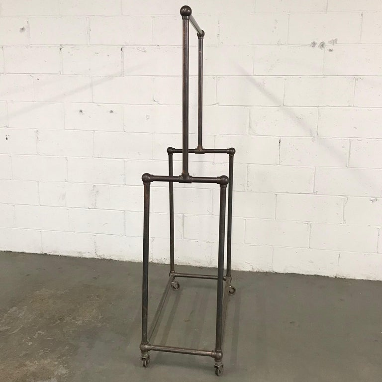 20th Century Deco Era Tubular Iron Rolling Garment Rack For Sale