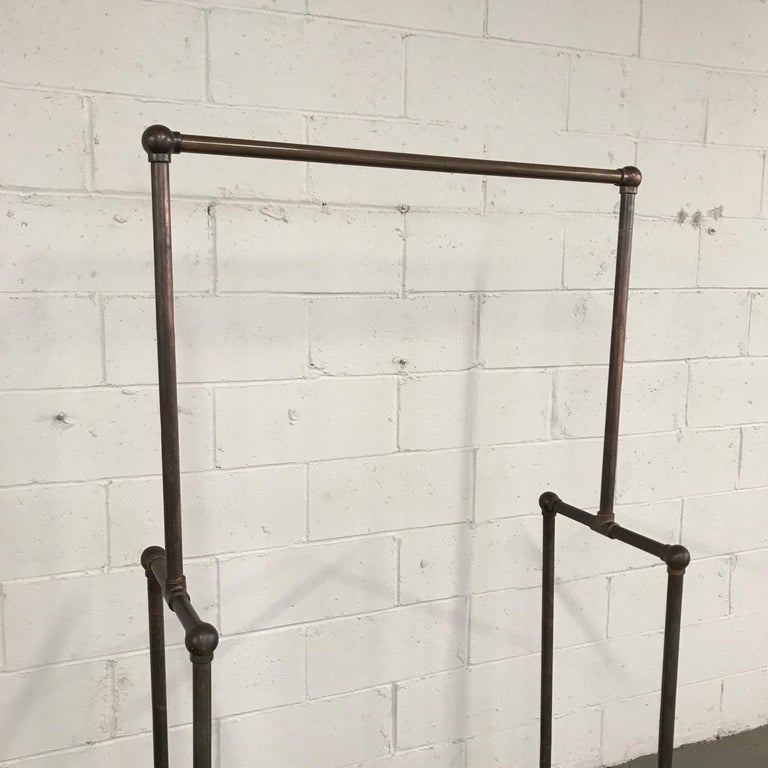 Deco Era Tubular Iron Rolling Garment Rack For Sale 1