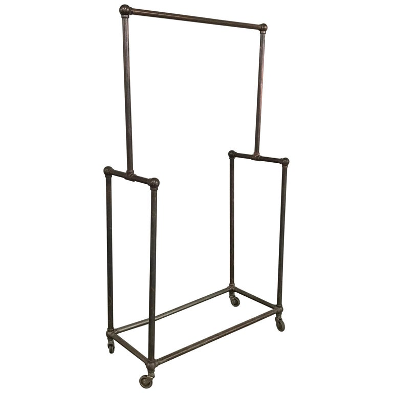 Deco Era Tubular Iron Rolling Garment Rack For Sale