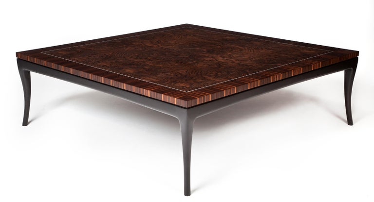 Deco-inspired large coffee table in Macassar ebony and burr walnut with a white metal inlay. The table top sits on a blackened frame with elegantly carved black legs.  Originally designed for clients with Art Deco interior styling, along with a