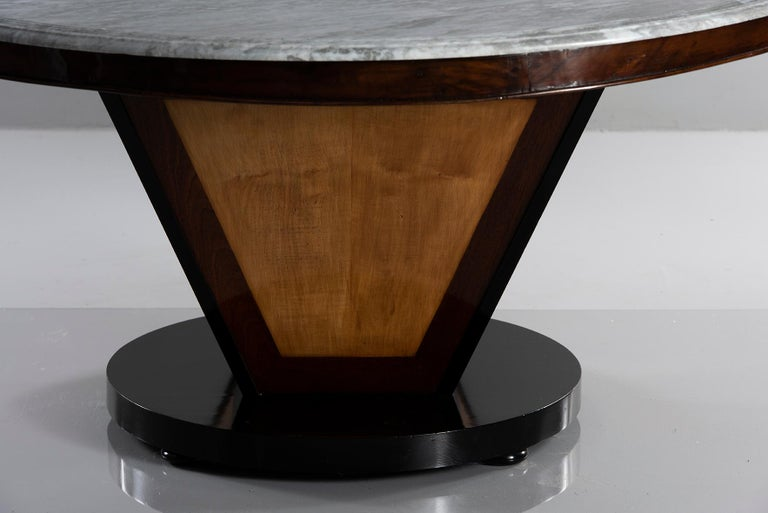"""White marble round top with gray veining is 63"""" diameter, circa 1970s. We had an English cabinet maker design and build a custom base for the table. Pedestal base features contrasting wood in Deco-inspired design. Base includes separate support for"""