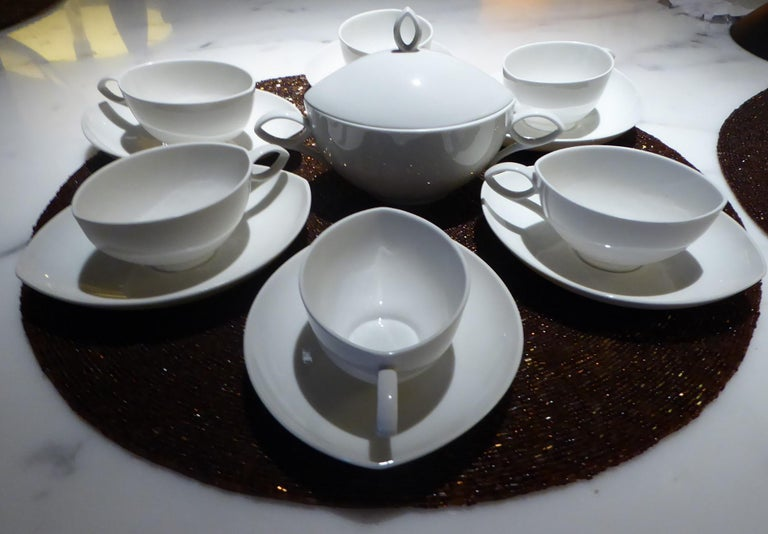 Designed by Rudolf Lunghard for Rosenthal, Mid-Century Modern set of 6 cups and saucers plus sugar with top in the demitasse, espresso or moka size. This lovely 1951 rarely seen set in fine translucent white porcelain is stamped with the old logo,