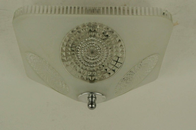 1-4067 deco style square shaped frosted /clear glass flush mount. Two 60 watt candelabra based internal light cluster. Newly rewired.  One available.