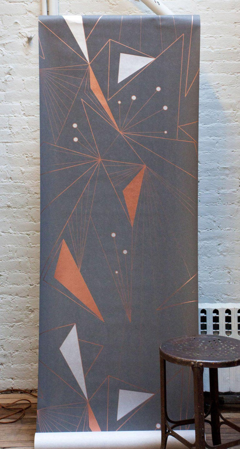 This modern, and geometric wallpaper adds graphic warmth and texture to your walls in a metallic palette of bronze/gold, copper and silver on a matte charcoal gray background. It works well with Mid-Century Modern, Hollywood Regency, Art Deco and
