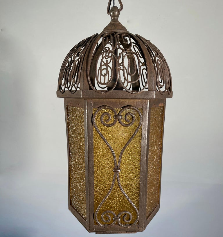 European Arts and Crafts Wrought Iron Pendant Light with Cathedral Glass Lantern For Sale