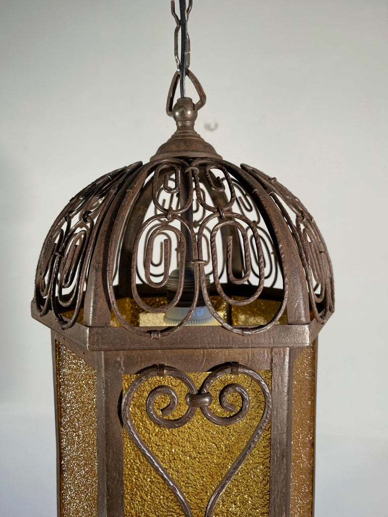 Hand-Crafted Arts and Crafts Wrought Iron Pendant Light with Cathedral Glass Lantern For Sale