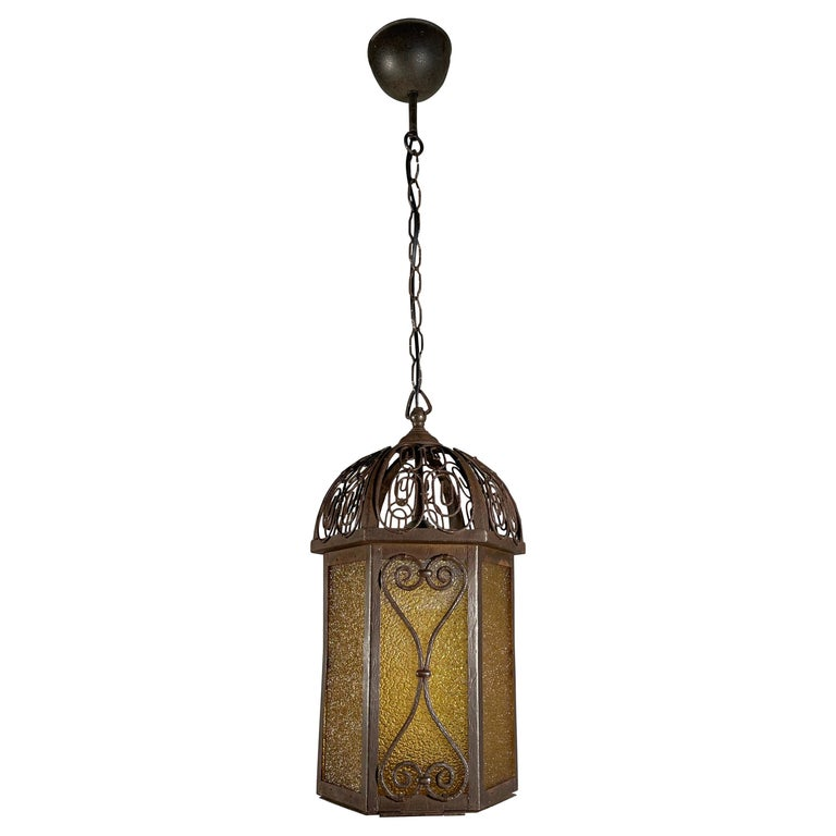 Arts and Crafts Wrought Iron Pendant Light with Cathedral Glass Lantern For Sale