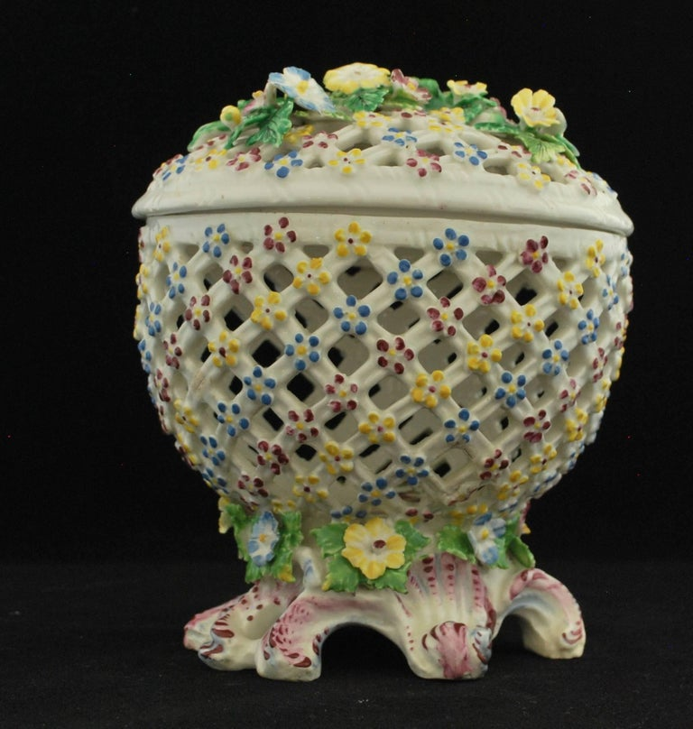 A pierced basket standing on a well-formed rococo base. Perhaps for potpourri, although the internal decoration suggests another use. We think probably oranges, chestnuts, etc.  Prov Taylor collection; Stockspring Antiques.