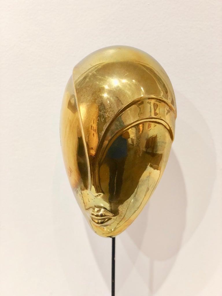 Hong Kong Decorative Brass Mask Sculpture Alien Face Art Deco on Stand For Sale