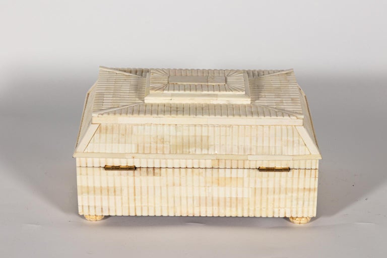 Decorative carved bone box with lid. Please note of wear consistent with age.