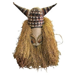 Decorative Large Adorned African Folk Art Mask with Horns on Display Stand