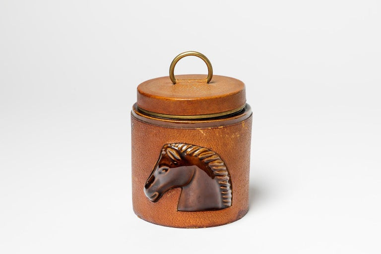 Longchamp  French leather and ceramic cigarette box by french luxury house  Original good condition, circa 1980  Signed under the base  Horse decoration  Measures: Height closed : 11 cm large : 10 cm.