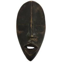 Decorative Mid-Century Modern African Folk Art Hanging Tribal Mask Sculpture