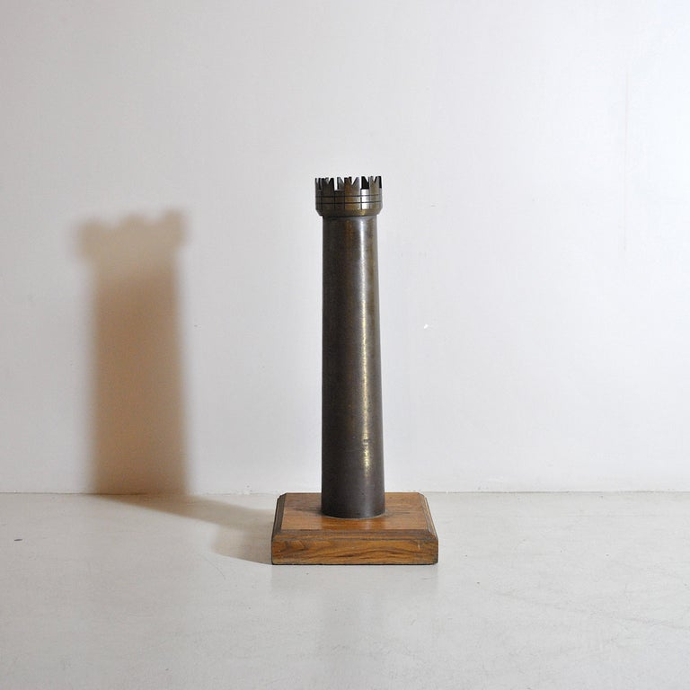 Original decorative object depicting an element of the game of chess, the rook, 1960s production in bronze with wooden base.