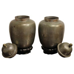 Decorative Pair of Metal Vessels with a Wooden Pedestal