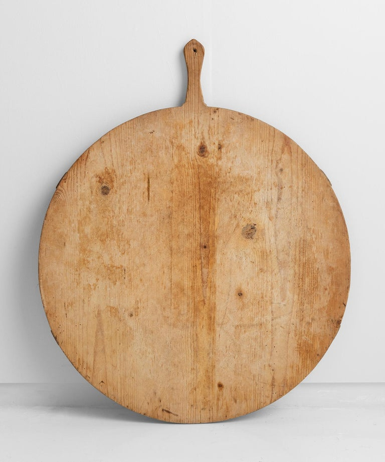 Worn pine peel board with hand painted flower motif on the back. Originally used as a surface for peeling vegetables.