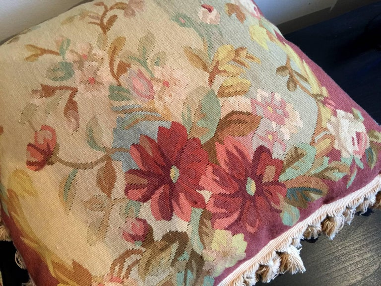 An elegant vintage French silk and wool cushion with antique style floral design. The cushion colors are consisting of ivory, gold, and pink.