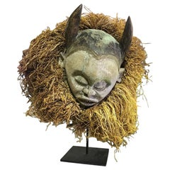 Decorative, Realistic Carved African Folk Art Mask with Horns on Display Stand