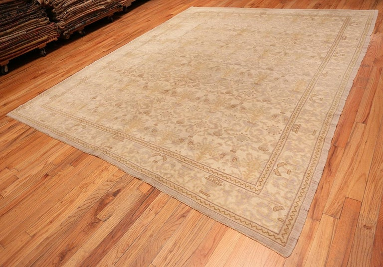 Decorative room size antique Spanish carpet, country of origin: Spain, date circa early 20th century. Size: 9 ft 3 in x 12 ft 3 in (2.82 m x 3.73 m)  The most notable feature about this antique Spanish carpet is the use of subtle sift and neutral