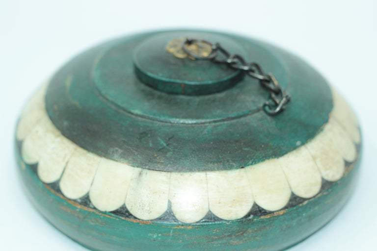 Round shaped lidded opium container box inlaid with bone and brass. Opium container handcrafted from a pice of wood, hand painted in hunter green with polished brass decor and chains and bone inlaid. The opium boxes from India usually had narrow