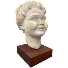 Decorative Sculpture of Putti's Head Plaster on Wooden Stand