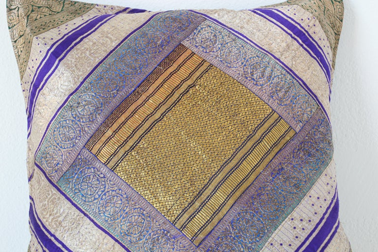 Decorative accent throw pillow made from vintage sari borders.