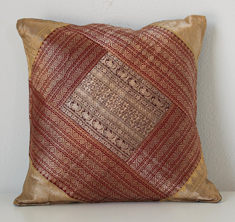 Decorative accent throw pillow made from vintage sari borders. One of a kind silk decorative pillow, red with gold metallic threads. Handcrafted in India. We do have multiple in this style, but each one is unique.