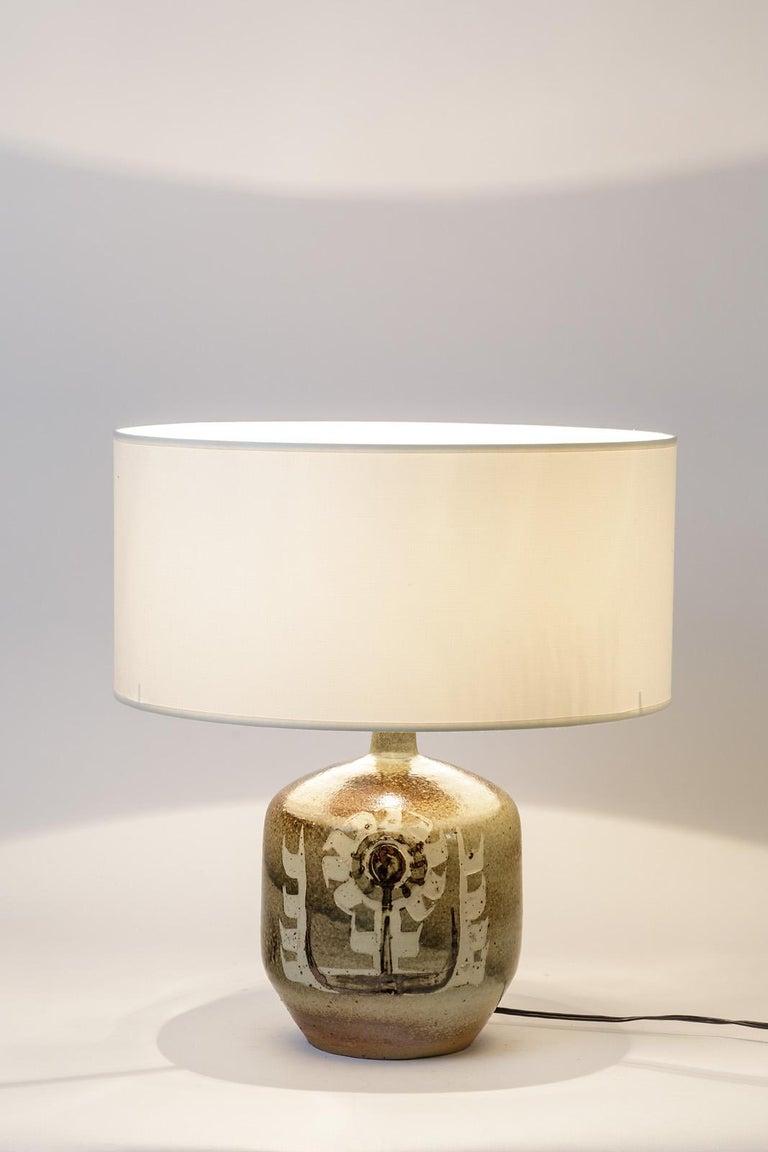 Pierre Digan (1941-2016)  Decorative handmade ceramic lamp realised by Pierre Digan.  Pierre Digan is one of the famous french ceramist of the 1970s.  ELegant flower decoration and stoneware ceramic glaze effects.  Excellent original