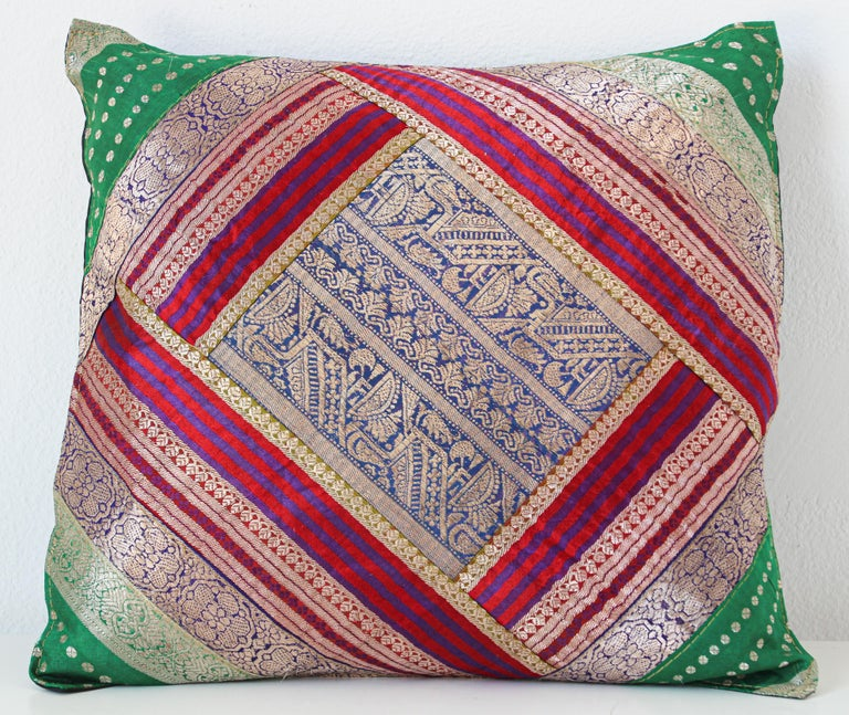 Decorative accent throw pillow made from vintage silk sari borders. One of a kind silk pillow in blue, green, gold, green, purple with metallic threads silk saris borders. Handcrafted in India. We do have multiple in this style, but each one is